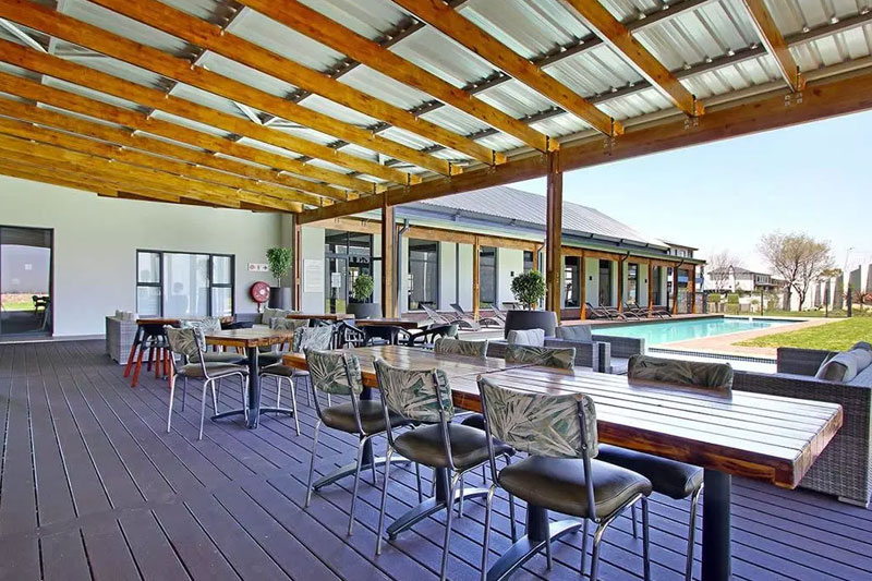 Relax after a swim in the pool at the Clubhouse at Umthunzi Valley.